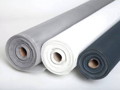 There are three rolls of plastic window screens in different colors.