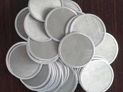Several aluminum woven cloth discs on the table.