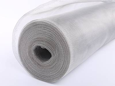 A roll of aluminum woven cloth on the white background.