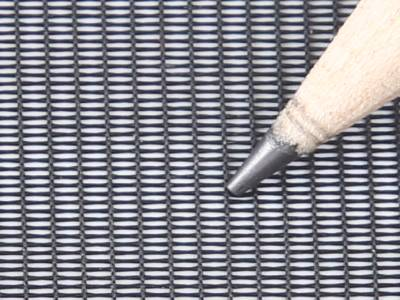 A pencil point on the dust screen.