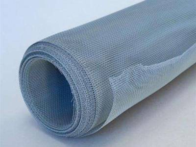 A roll of aluminum alloy mosquito netting on the white background.