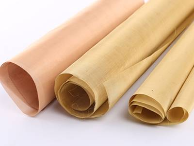 Three rolls of copper mosquito netting on the white background.