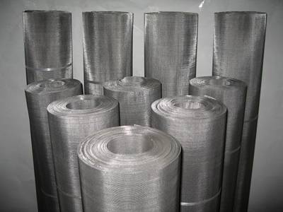 Several rolls of 304 stainless steel mesh rolls on the gray background.