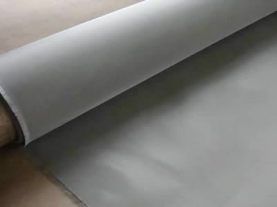 There is a titanium wire fine cloth roll with silver color.